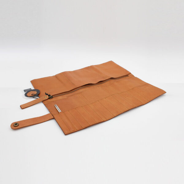 Display of the Stockholm leather needle organizer by Muud, in the whisky colorway, open