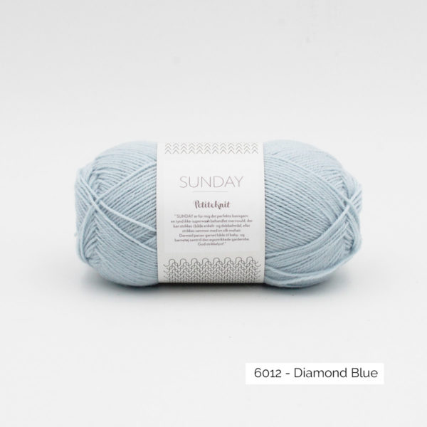 A ball of Sandnes Garn's Sunday by Petite Knit in the Diamond Blue colorway