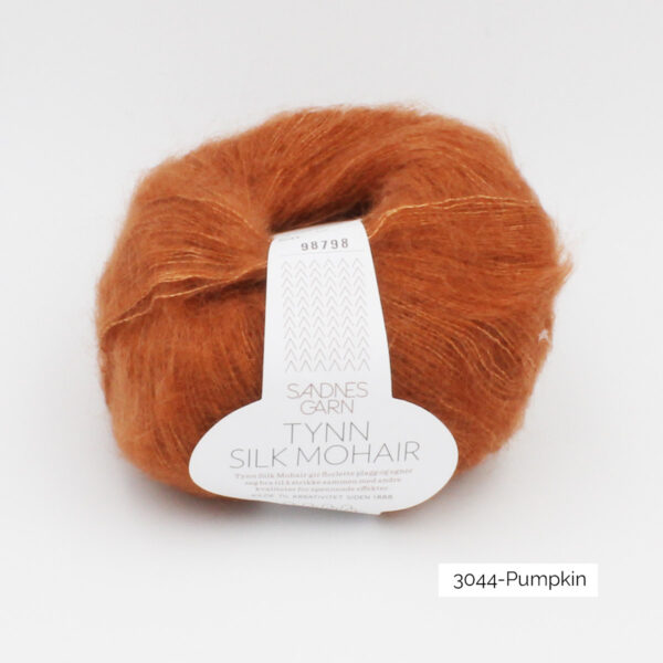 A ball of Sandnes Garn's Tynn Silk Mohair in the Pumpkin colorway