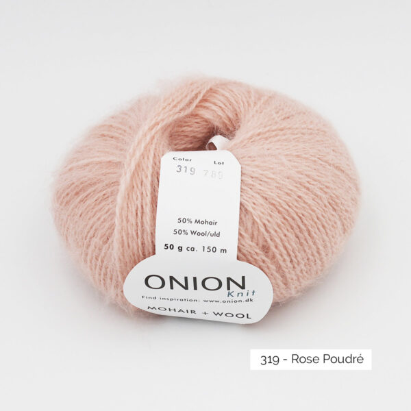 A ball of Onion Mohair + Wool in the Rose Poudré colorway (powder pink)