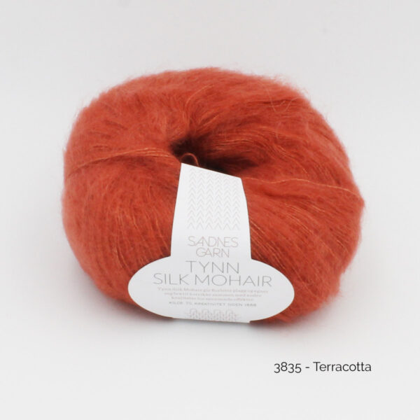 A ball of Sandnes Garn's Tynn Silk Mohair in the Terracotta colorway