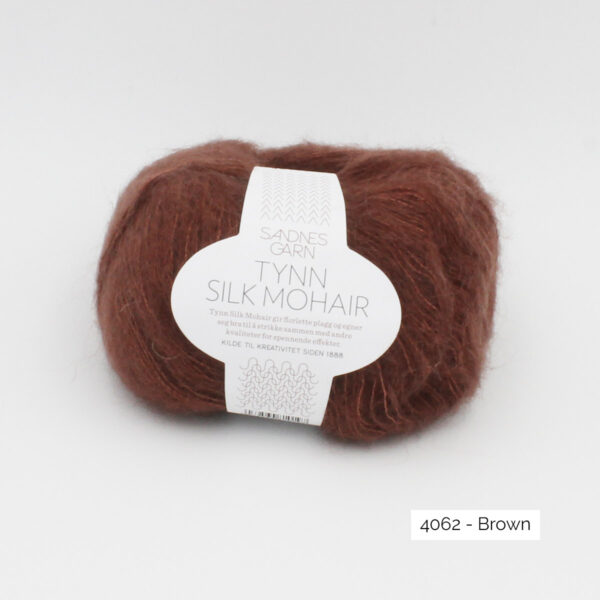 A ball of Sandnes Garn's Tynn Silk Mohair in the Brown colorway