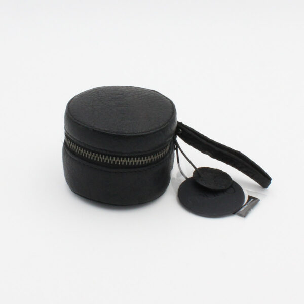 Display of the small Helsinki cylindrical leather pouch by Muud, in black