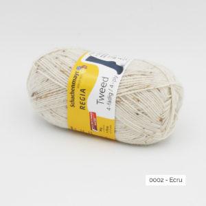 A ball of Regia 4-fädig Tweed in the Ecru colorway (natural)