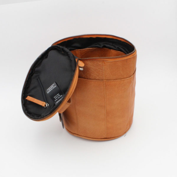 Display of a leather Saturn project bag, by Muud, in the whisky colorway, open