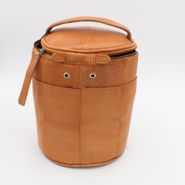 Display of a leather Saturn project bag, by Muud, in the whisky colorway