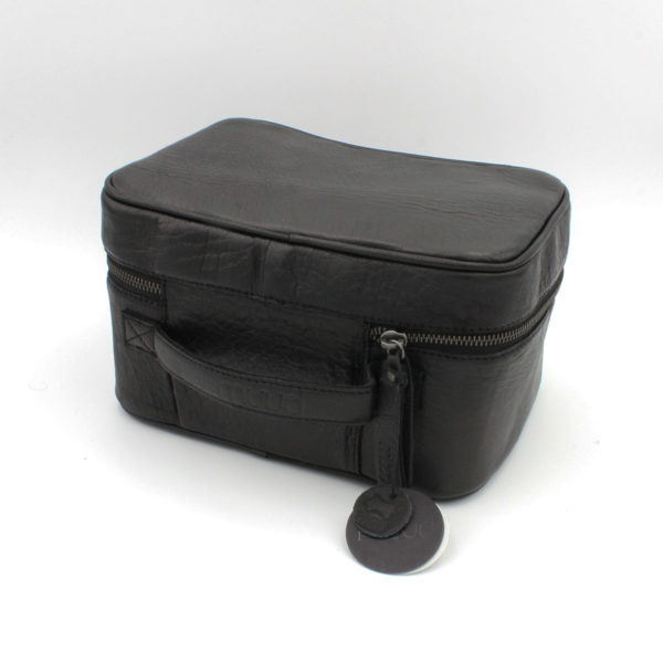 "Display of a Shadow leather project bag, shaped as a ""beauty case"", made by Muud, in the black"