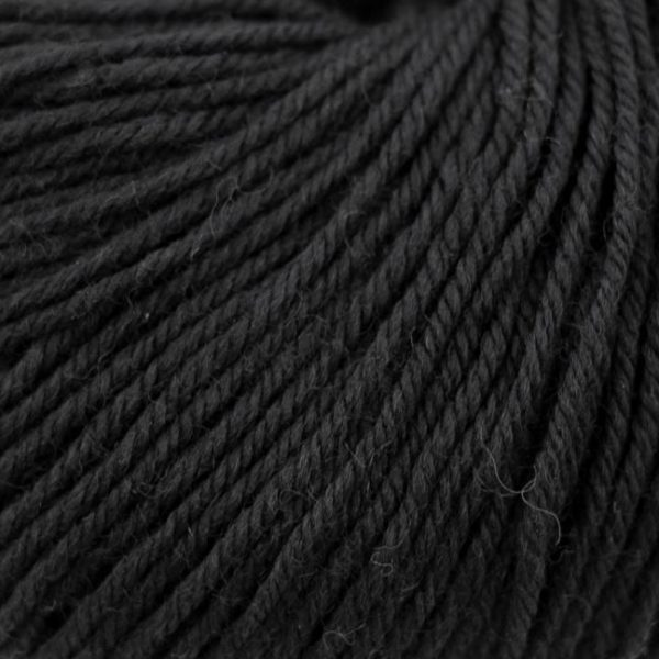 Zoom on a ball of Kremke Soul Wool's Bébé Soft Wash in the Noir colorway (black)