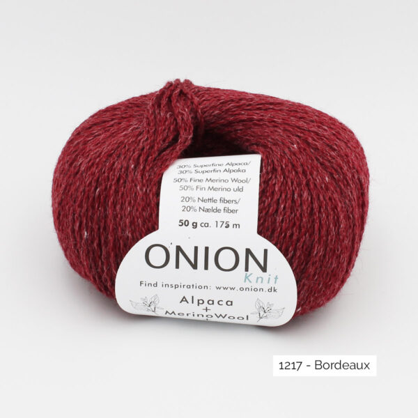 One ball of Onion Alpaca Merino Nettles, in the Bordeaux colorway (deep burgundy red)