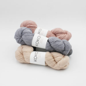 Three skeins of Kokon's Merino Fingering, in the Clay, Stone and Cloud colourways