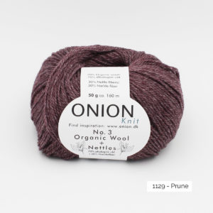 A ball of Onion's Organic Wool + Nettles n°3 in the Prune colorway (plum)
