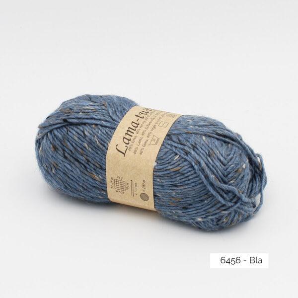 A ball of CaMaRose Lama Tweed in the Bla colorway (medium blue))