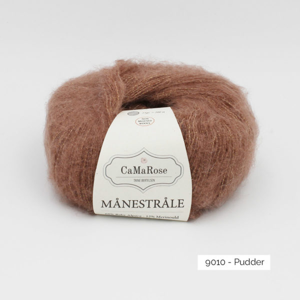 A ball of CaMarose Manestrale in the Pudder colorway (dark powder pink)