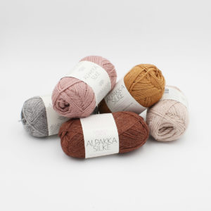 5 balls of Sandnes Garn Alpakka Silke, in the colorways Grey, Dusty Pink, Powder Pink, Golden Brown and Host