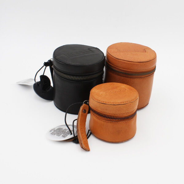 Display of three Rock and Helsinki leather cylindrical pouches by Muud, in assorted colours