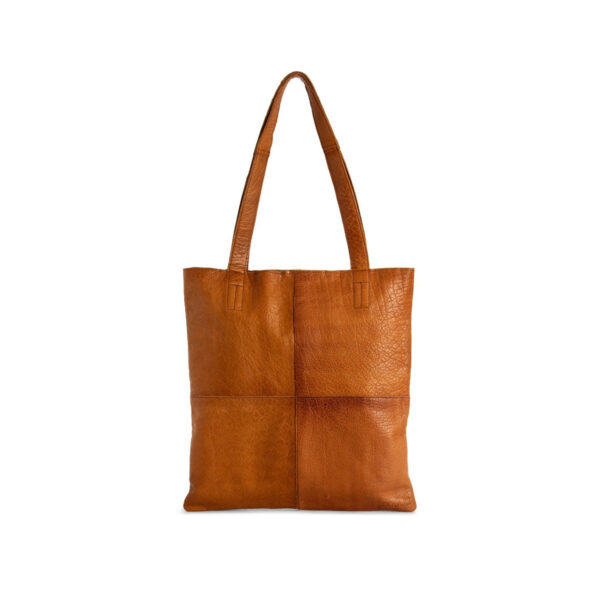 Display of a Show leather tote bag, made by Muud, in the whisky colorwayDisplay of a Show leather tote bag, made by Muud, in the whisky colorway