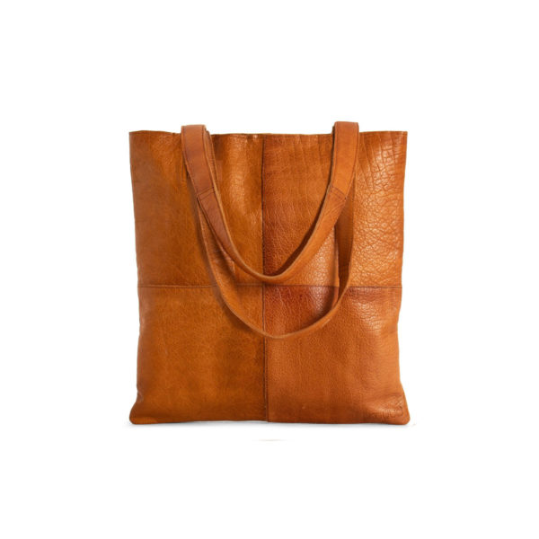 Display of a Show leather tote bag, made by Muud, in the whisky colorway