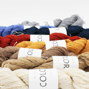 Zoom on a display of 8 skeins of Colori by BC Garn in different colours
