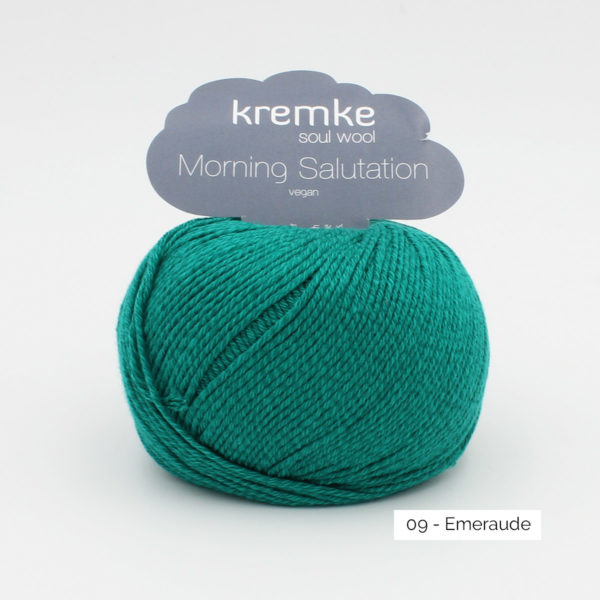 A ball of Kremke's Morning Salutation in the Emeraude colorway (emerald)