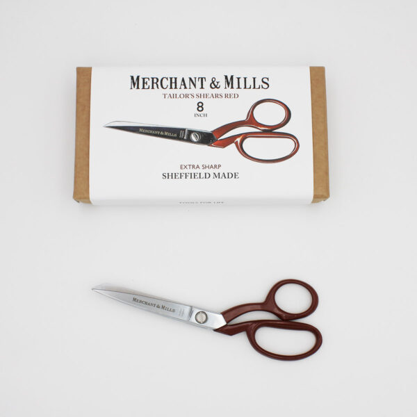 """Merchant & Mills Red Extra Sharp Tailor Shears, 20cm (8"""") long, with a red handle, displayed next to their cardboard box"""