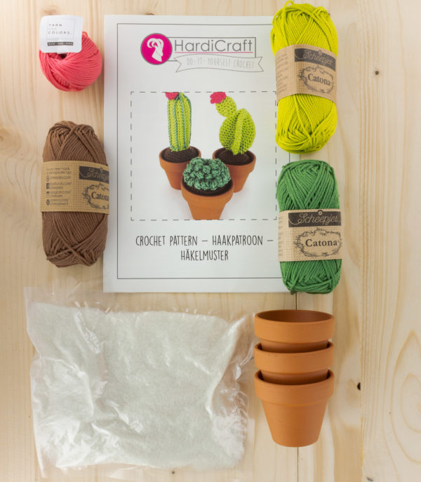 Hardicraft cactus crochet kit displayed. Contains 4 balls of assorted cotton, stuffing, a pattern leaflet and 3 clay pots