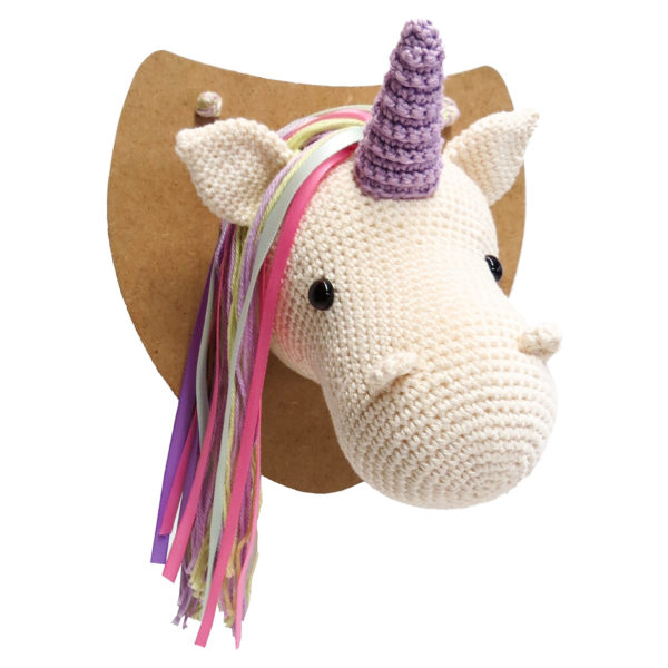 Crocheted unicorn head wall ornament, white with a purple horn and pink, purple and aqua hair, to be made with a Hardicraft crochet kit