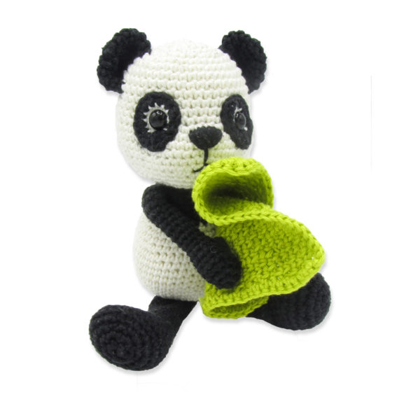 Crocheted black and white panda with its green security blanket, to be made with a Hardicraft crochet kit