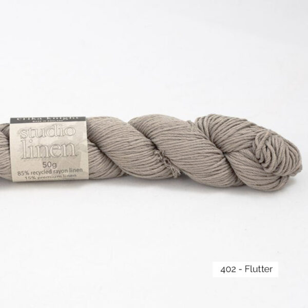 One skein of Studio Linen by Erika Knight in the Flutter colorway (beige taupe)