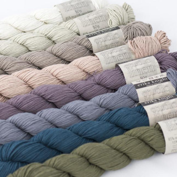Eight skeins of Studio Linen by Erika Knight in assorted colors