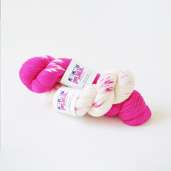 Two skeins of Kokon fingering yarn in its Pink limited edition