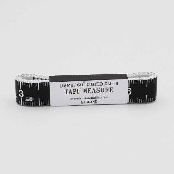 Merchant & Mills black and white tape measure, wrapped in its assorted cardboard packaging