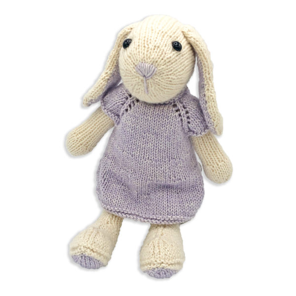 Chloe the Hare, knitted with a Hardicraft softie kit, light beige and mauve hare, wearing a mauve dress