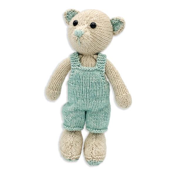 John the Bear, knitted with a Hardicraft softie kit, light beige and light blue teddy bear, wearing a light blue jumpsuit