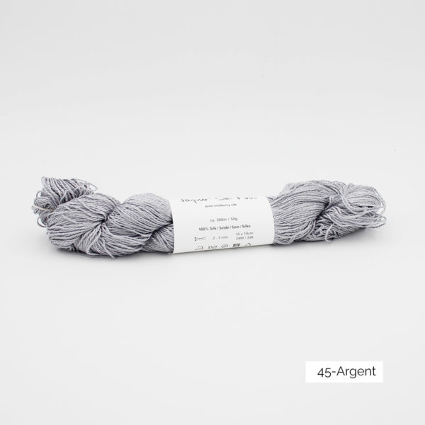A skein of Jaipur Silk Fino by BC Garn in the Argent colorway (silver)