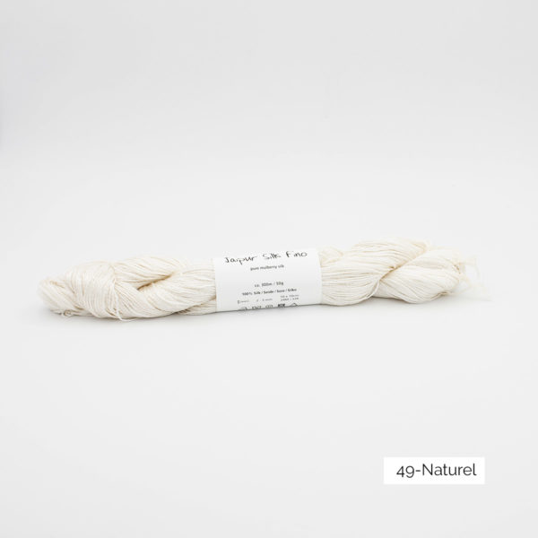 Zoom on a skein of Jaipur Silk Fino by BC Garn in the Naturel colorway (off white)