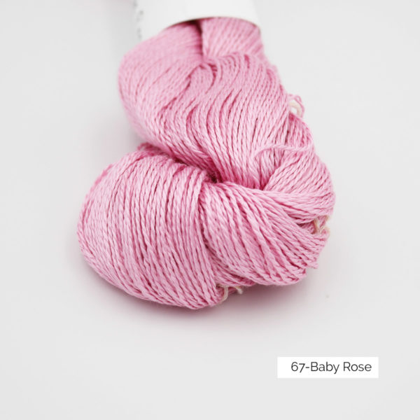 Zoom on a skein of Jaipur Silk Fino by BC Garn in the Baby Rose colorway (medium pink)