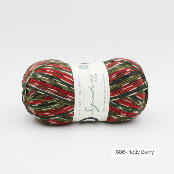 A ball of WYS special Christmas socks yarn, in the Holly Berry colorway (white, red and green motif)