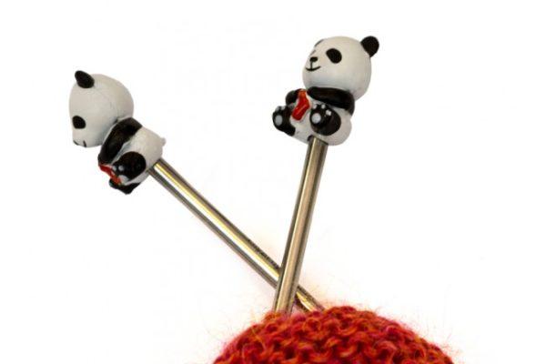 Display of two needle tips protectors shaped as small pandas holding socks of the Hiya Hiya brand