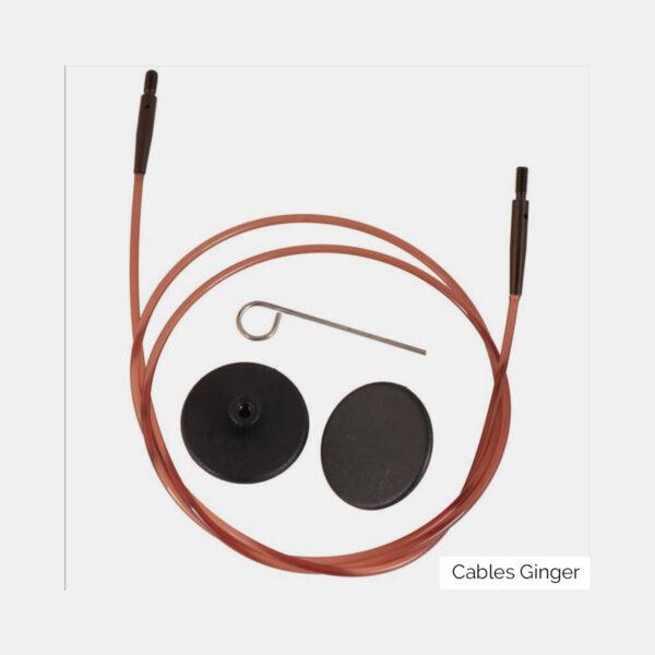 Un câble Knit Pro de la gamme Ginger, marron avec embouts métalliques noirs, et ses accessoires