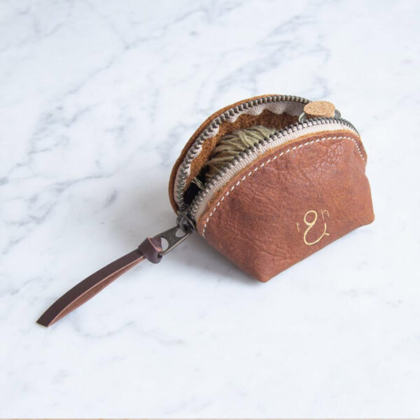 """Display of a """"dumpling"""" leather pouch by Twig & Horn"""