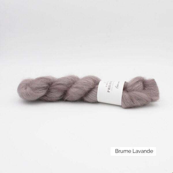A skein of Leona by Emilia & Philomène in the Brume Lavande colorway
