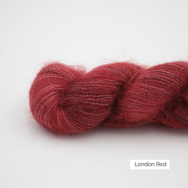 Zoom on a skein of Leona by Emilia & Philomène in the London Red colorway (nuances of red)