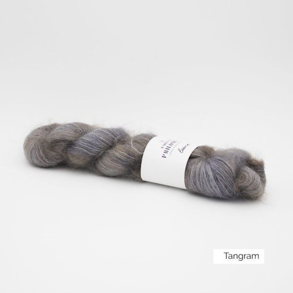 A skein of Leona by Emilia & Philomène in the Tangram colorway (grey with a bit of light brown)
