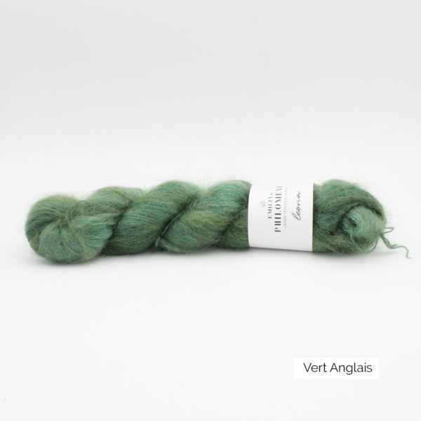A skein of Leona by Emilia & Philomène in the English Green colorway