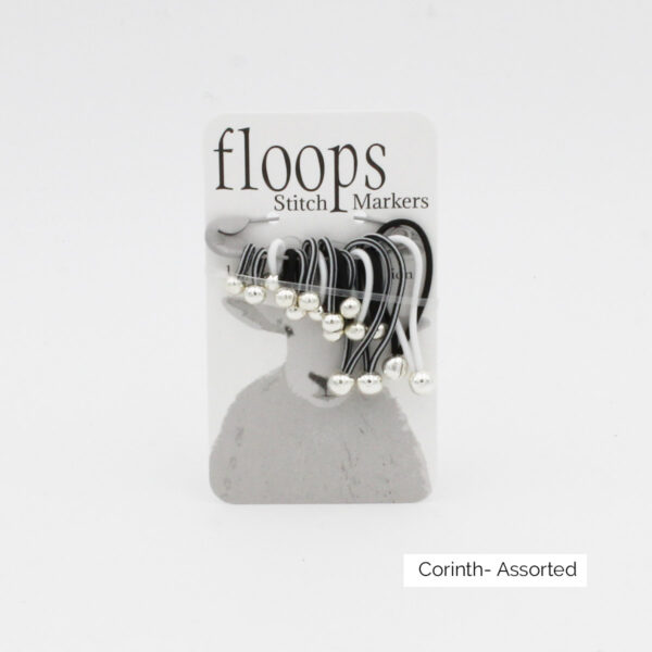 A card of flexible Floops Stitch Markers in the Corinth colours (black and white) and assorted sizes