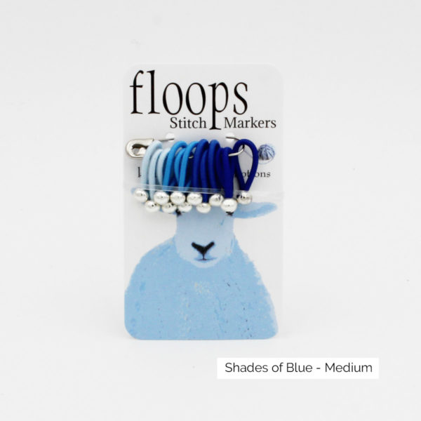 A card of flexible Floops Stitch Markers in shades of blue and medium size