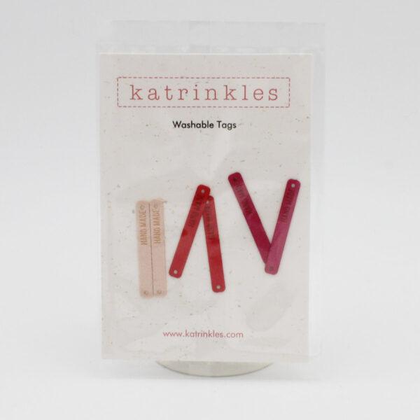 Lot de 6 étiquettes lavables gravées HAND MADE de la marque Katrinkles dans les teintes roses