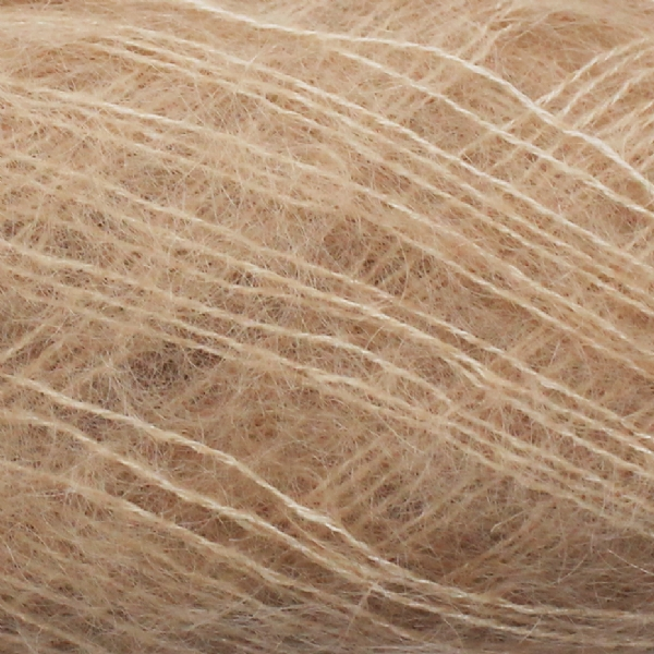 Zoom on a ball of Isager's Silk Mohair in the Beige colorway