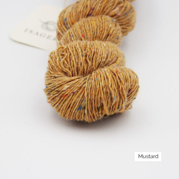 Zoom on a skein of Isager's Tweed in the Mustard colorway