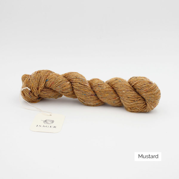 A skein of Isager's Tweed in the Mustard colorway